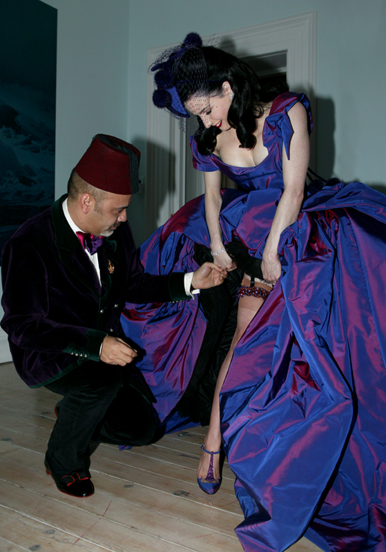 The wedding of Dita Von Teese and Marilyn Manson at Gurteen Castle in Ireland on December 3, 2005. The dress was by Vivienne Westwood and the shoes by Christian Louboutin, who is adjusting her garter in this shot.