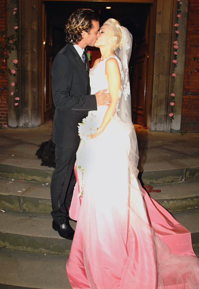 The wedding of Gwen Stefani and Gavin Rossdale at St. Paul's Church in Covent Garden on September 14, 2002.  The dress was by John Galliano for Dior. Gavin's suit was by Dior Homme.