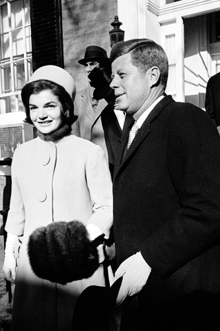 Jacqueline Kennedy, with John F. Kennedy wearing a Halston pillbox hat for the 1961 Presidential Inauguration.