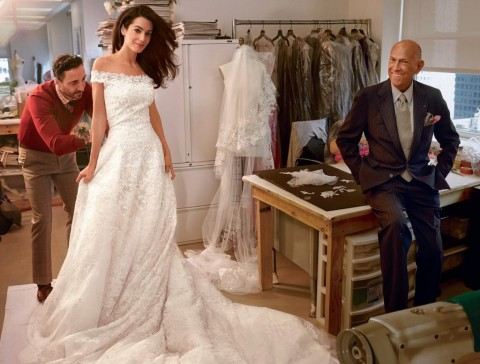 Amal Alamuddin, now Mrs. George Clooney in Oscar De La Renta with the Master himself overseeing.