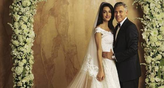 Amal Alamuddin, now Mrs. George Clooney in Oscar De La Renta with her husband.