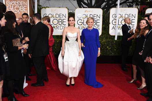 Amy Poehler (with Tina Fey) arriving at the Golden Globes 2015.